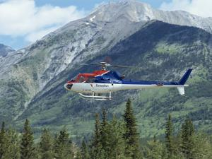 Helicopter in the Rocky Mountains, British Columbia, Canada, North America by Robert Harding