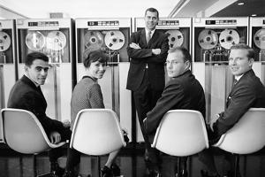 Ibm Executives Pose, Seated in Front of a Bank of 7094 Ii Computers, 1962 by Robert Kelley