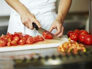 Chef Chopping Tomatoes by Robert Kneschke