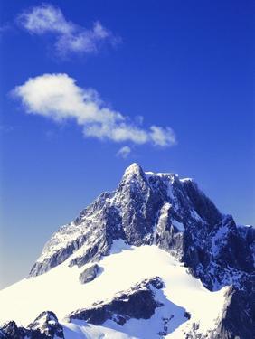 Snow Covered Mountain Peak by Robert Landau