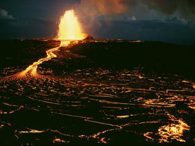 A Blazing Fountain and a River of Lava Pour from a Vent of the Volcano