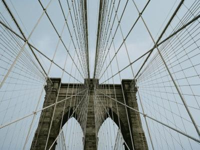 Cables Form an Abstract Web Around the Points of Two of the Bridges Archways
