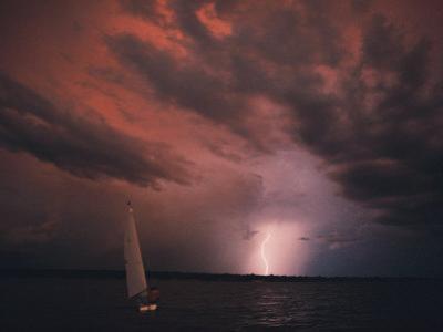 Sailboat under a Lightning-Filled Sky