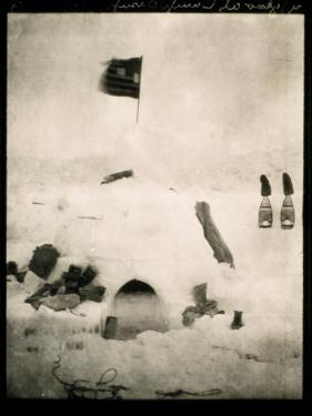 Commander Pearys Igloo is Marked by an American Flag on Top and Surrounded by Scattered Supplies by Robert Peary