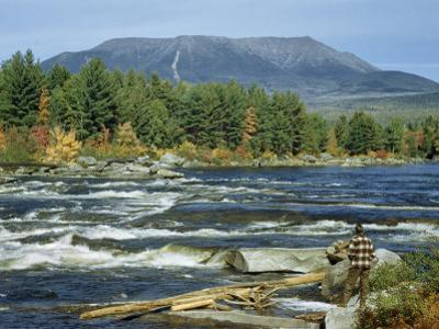 Man Standing on Riverbank at Abol Falls Looks Toward Mount Katahdin by Robert Sisson
