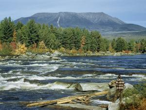 Man Standing on Riverbank at Abol Falls Looks Toward Mount Katahdin by Robert Sisson