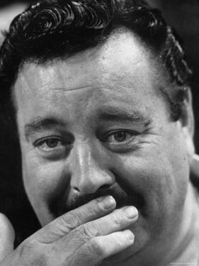 Actor Jackie Gleason Hiding His Mustache by Robert W. Kelley