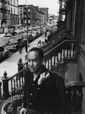 African American Poet/Writer Langston Hughes Standing on the Stoop in Front of His House in Harlem by Robert W. Kelley