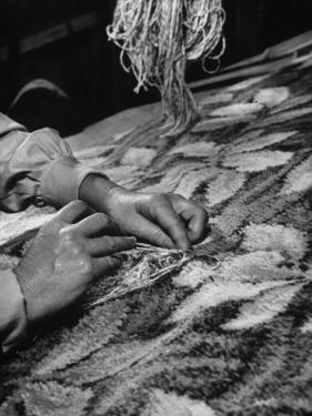 Builders Hands Repairing Minor Defect in Rug, at Alexander Smith Carpet Mill by Robert W. Kelley
