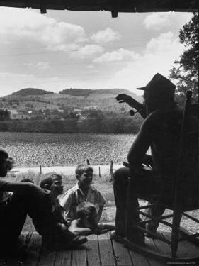 Ervin Merriman Telling Children About His Childhood by Robert W. Kelley