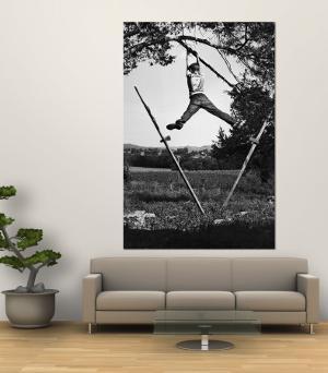 Kenneth Merriman Swinging on Tree Limb After Kicking Away Stilts by Robert W. Kelley