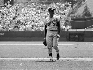 Los Angeles Dodgers Pitcher Sandy Koufax Taking the Field During Game Against the Milwaukee Braves by Robert W. Kelley