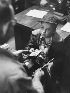 Small Boy Purchasing a Screwdriver at a Local Hardware Store by Robert W. Kelley