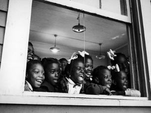 Students Looking Out the Window of the All Black Thomy Lafon School by Robert W. Kelley