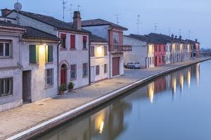 Italy, Emilia Romagna, Comacchio Houses by a Canal by Roberto Cattini