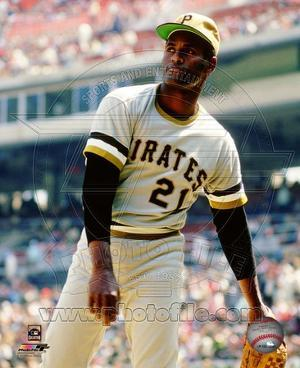 Roberto Clemente #21 of the Pittsburgh Pirates limbers up his arm prior to a game.
