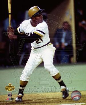 Roberto Clemente #21 steps into the swing during the 1971 World Series against the Baltimore Oriole