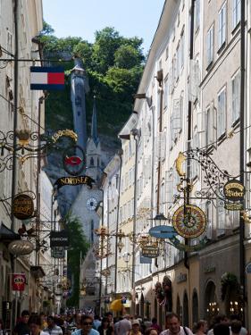 Shop Signs and Buildings on Getreidegasse Lane by Roberto Gerometta