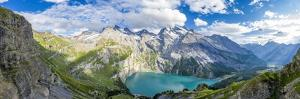Aerial panoramic of Oeschinensee lake surrounded by woods in summer, Switzerland by Roberto Moiola