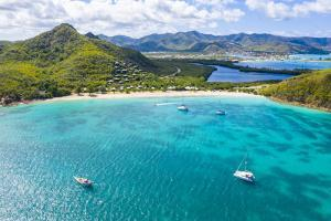 Aerial view by drone of Hermitage Bay and Caribbean Sea, Antigua by Roberto Moiola