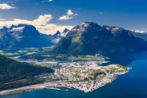 Aerial view by drone of mountains and fjord surrounding Andalsnes town by Roberto Moiola