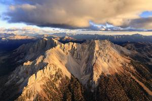 Aerial view of the rocky peaks of Latemar at sunset, Dolomites, South Tyrol, Italy, Europe by Roberto Moiola