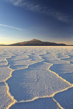 An Andean Volcano Rises Above the Salar De Uyuni by Roberto Moiola