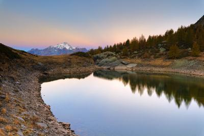 Autumnal sunrise on Monte Disgrazia and Lakes of Campagneda, Valmalenco, Valtellina by Roberto Moiola