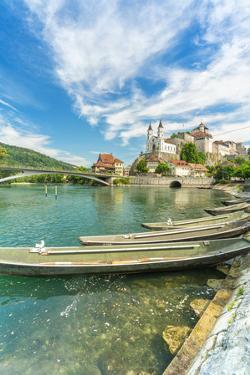 Boats moored in Aare River with Aarburg Castle in background, Aarburg, Switzerland by Roberto Moiola
