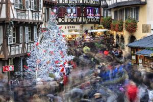 Christmas tree and Santa Claus in the pedestrian roads of the old town, Colmar, Haut-Rhin departmen by Roberto Moiola