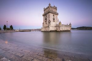 Colorful Dusk on the Tower of Belem, UNESCO World Heritage Site, Reflected in Tagus River by Roberto Moiola