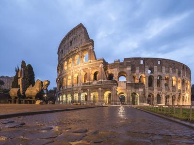 Dusk lights on the Colosseum (Flavian Amphitheatre), UNESCO World Heritage Site, Rome, Lazio, Italy