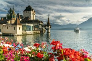 Flowers framing Oberhofen Castle and Lake Thun, Canton of Bern, Switzerland by Roberto Moiola
