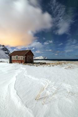 House Surrounded by Snow in a Cold Winter Day by Roberto Moiola
