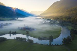 Mist over the cultivated fields along Stryneelva river by Roberto Moiola