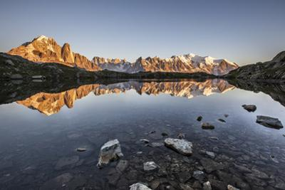 Mont Blanc Range Reflected at Sunrise from the Shore of Lac Des Cheserys by Roberto Moiola
