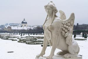 Mythological statue in the snow covered Belvedere Garten, Austria by Roberto Moiola
