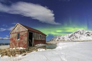 Northern Lights (Aurora Borealis) over an Abandoned Log Cabin Surrounded by Snow and Ice by Roberto Moiola