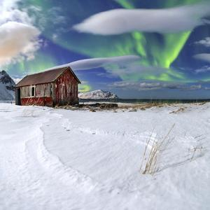 Northern Lights (Aurora Borealis) over an Abandoned Log Cabin Surrounded by Snow by Roberto Moiola