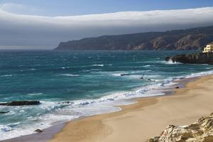 Ocean Waves Crashing on the Sandy Beach of Cascais, Surrounded by Cliffs, Estoril Coast by Roberto Moiola