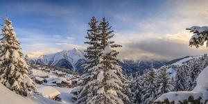 Panorama of Snowy Woods and Mountain Huts Framed by Sunset, Bettmeralp, District of Raron by Roberto Moiola