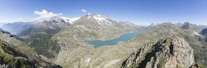 Panorama of the blue Lago Bianco surrounded by high peaks, Bernina Pass, Canton of Graubunden, Enga by Roberto Moiola