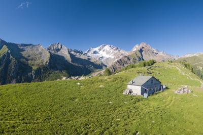 Panoramic aerial view of hut on green meadows, Scermendone Alp, Sondrio province, Valtellina by Roberto Moiola