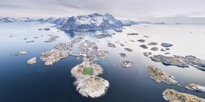 Panoramic aerial view of soccer pitch and islets, Henningsvaer, Vagan municipality, Norway by Roberto Moiola