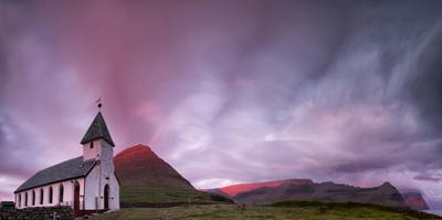 Panoramic of church of Vidareidi at sunrise, Vidoy island, Faroe Islands, Denmark by Roberto Moiola