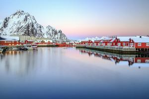 Pink Sunset over the Typical Red Houses Reflected in the Sea by Roberto Moiola
