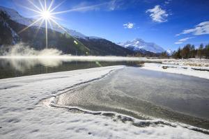 Rays of Winter Sun Illuminate Lake Silvaplana Still Partially Frozen, Switzerland by Roberto Moiola