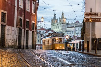 Romantic Atmosphere in Old Streets of Alfama with Castle in Background and Tram Number 28