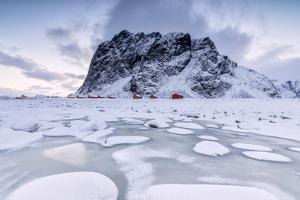 Snowy Peaks and Ice Frame the Typical Fishermen Houses Called Rorbu, Eggum by Roberto Moiola