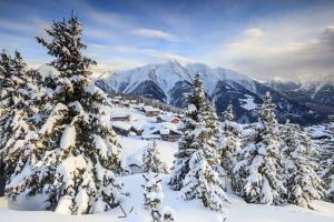 Snowy Woods and Mountain Huts Framed by the Winter Sunset, Bettmeralp, District of Raron by Roberto Moiola